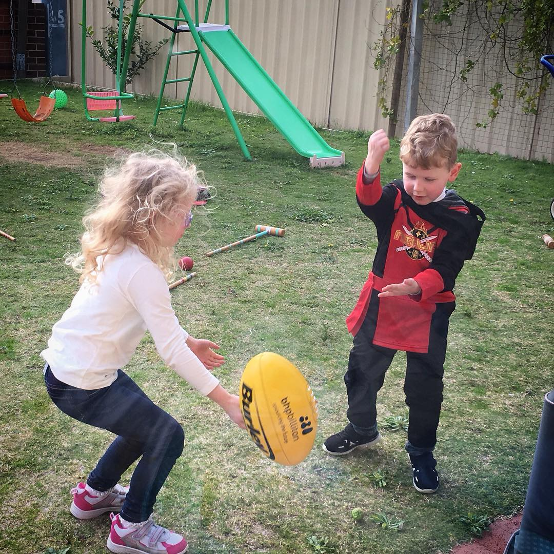 5. E is for... Educate #EdwardJames is teaching #EmilyCeleste how to handpass #afl #fms_Eisfor #fmsphotoaday #littlemomentsapp