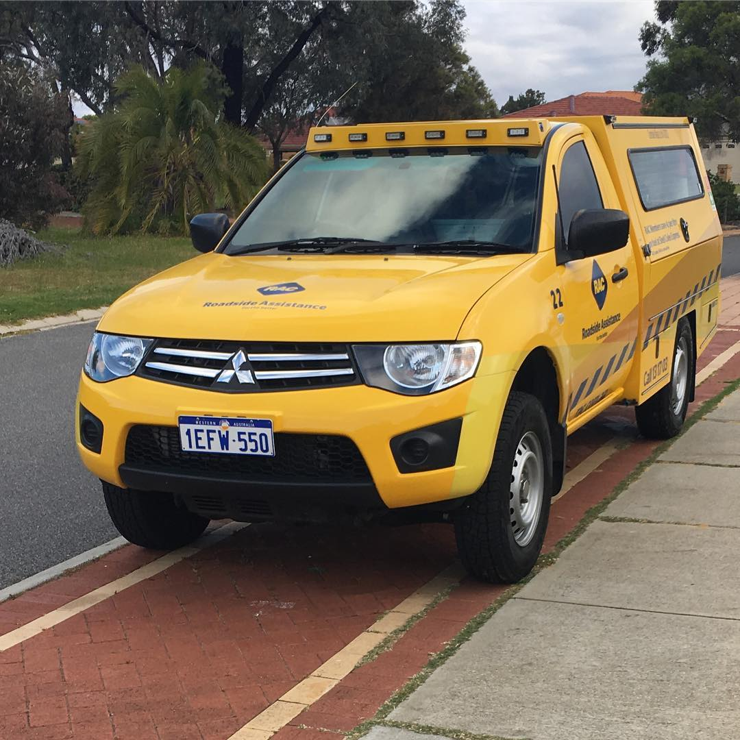 "While walking home from the library today #EdwardJames informs me, ""We should get at car like that one, it is cool"" @racwa (For those not in the know, these yellow utes are RAC roadside assistance vehicles in Perth)"